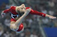 USA women's gymnasts stumble but recover - Team finals will be two-horse race between Americans, Chinese